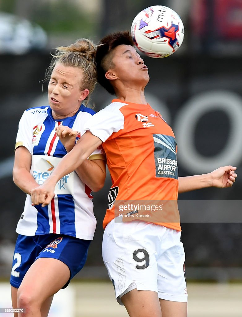 Wai Ki Cheung of the Roar and Hannah Brewer of the Jets challenge for the ball during the round seven W-League match between the Brisbane Roar and the Newcastle jets at AJ Kelly Reserve on December 10, 2017 in Brisbane, Australia.