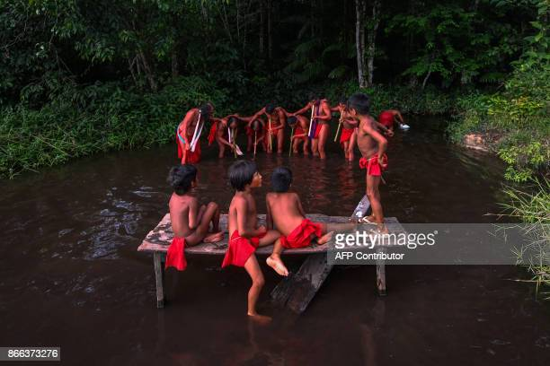 Waiapi men dance and play flute during the Anaconda's party during which they make flutes to play and dance and at the end leave all flutes on the...