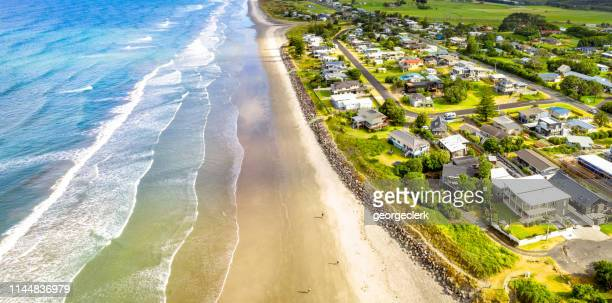 waihi beach on new zealand's coromandal peninsula - coastline stock pictures, royalty-free photos & images