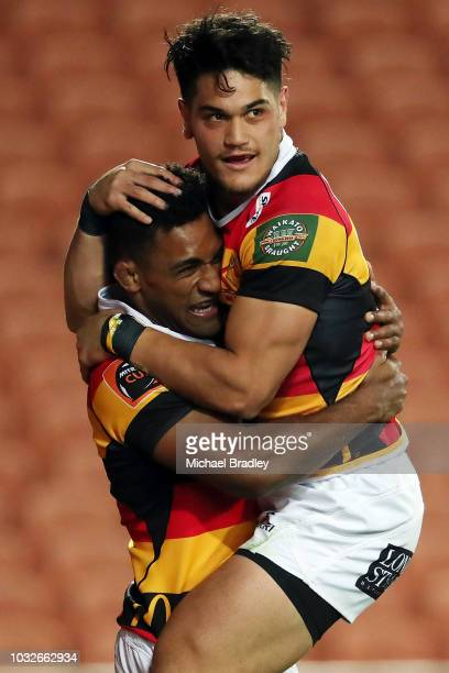 Waikato's Sevu Reece celebrates his try with team mate Quinn Tupaea during the round five Mitre 10 Cup match between Waikato and Hawke's Bay on...
