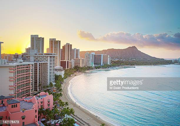 waikiki beach at sunrise - waikiki stock pictures, royalty-free photos & images