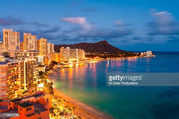 waikiki beach hawaii dusk - oahu stock pictures, royalty-free photos & images