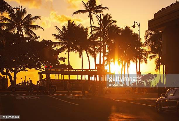 waikiki beach sunset - waikiki stock pictures, royalty-free photos & images