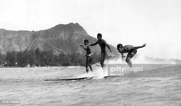 Boys surfing at Waikiki Hawaii Undated photograph