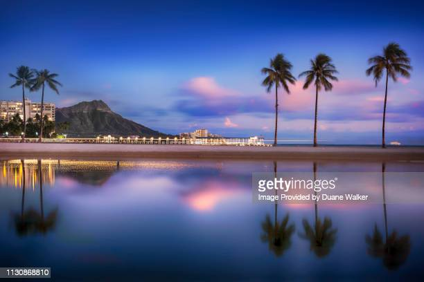 waikiki lagoon at sunset - ダイヤモンドヘッド ストックフォトと画像