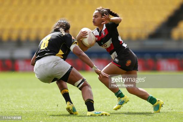Waikohika Flesher of Counties Manukau attempts to evade Jackie PateaFereti of Wellington during the round 3 Farah Palmer Cup match between Wellington...
