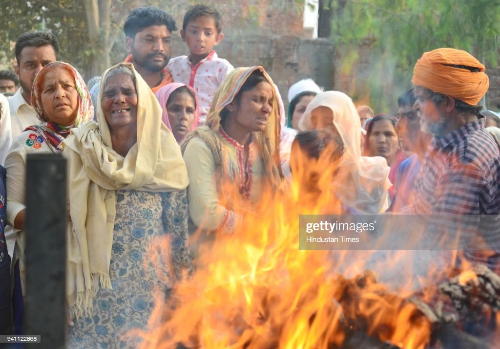 Wailing family members of Sonu who killed in Iraq during his cremation at his native village Chawinda Devi on April 2 2018 near Amritsar India A...