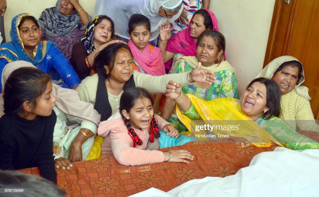 Wailing Surjit Kaur and family members of Ustad Pyarelal Wadali after his death at his native village Guru Ki Wadali on March 9 2018 in Amritsar India