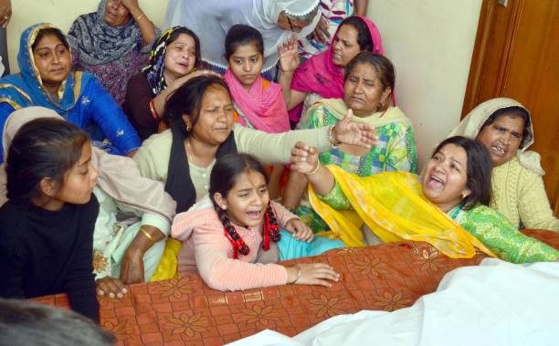 Wailing Surjit Kaur and family members of Ustad Pyarelal Wadali after his death at his native village Guru Ki Wadali on March 9 2018 in Amritsar India