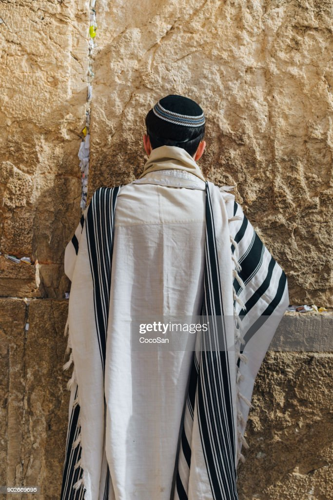 Wailing Wall and Jewish believers praying in front of the sacred place in Israel : Stock Photo