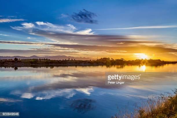 wairau river at sunset, wairau bar, blenheim, marlborough, south island, new zealand - blenheim new zealand stock pictures, royalty-free photos & images