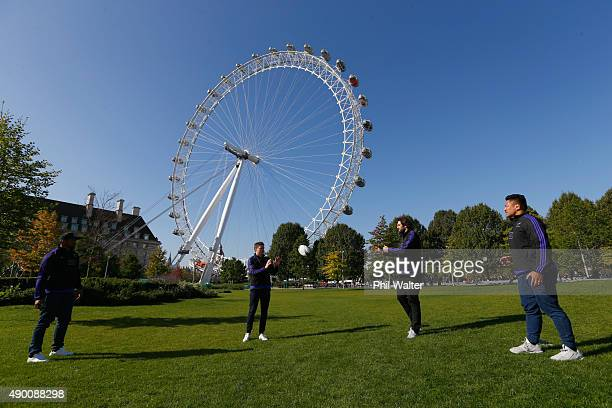 Waisake Naholo Beauden Barrett Samuel Whitelock and Keven Mealamu of the All Blacks pass the ball below the London Eye on an open top bus tour with...