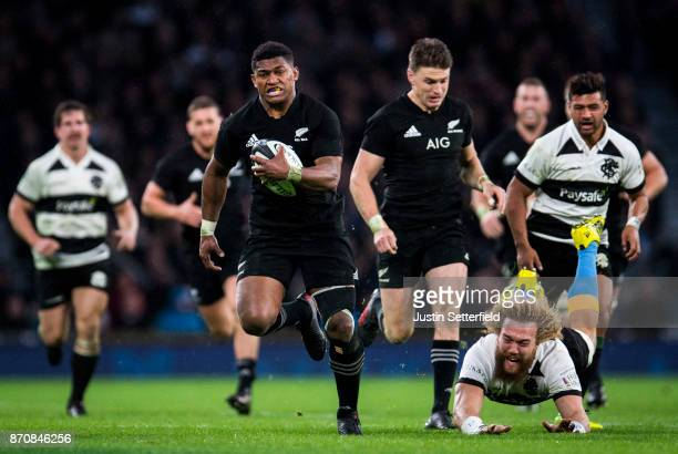 Waisake Naholo of New Zealand evades the tackle of Willie Britz of Barbarians during the Killik Cup between Barbarians and New Zealand at Twickenham...