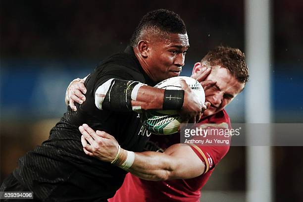 Waisake Naholo of New Zealand fends against Hallam Amos of Wales during the International Test match between the New Zealand All Blacks and Wales at...