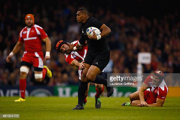 Waisake Naholo of New Zealand hands off Alexander Todua of Georgia during the 2015 Rugby World Cup Pool C match between New Zealand and Georgia at...