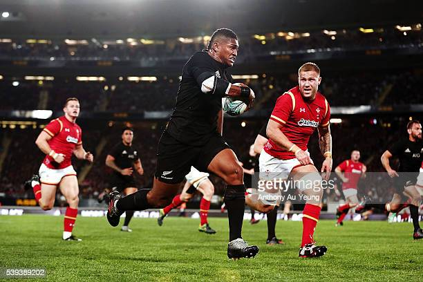 Waisake Naholo of New Zealand makes a break against Ross Moriarty of Wales during the International Test match between the New Zealand All Blacks and...