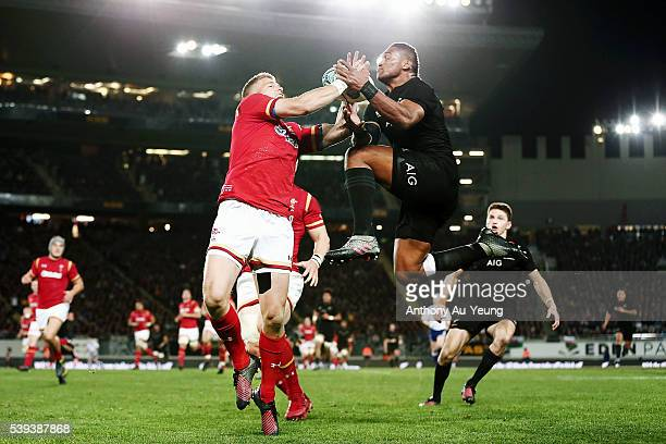 Waisake Naholo of New Zealand takes a high ball against Gareth Anscombe of Wales during the International Test match between the New Zealand All...