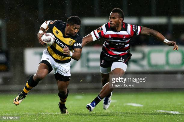 Waisake Naholo of Taranaki is tackled by Tevita Nabura of Counties Manukau during the round three Mitre 10 Cup match between Taranaki and Counties...