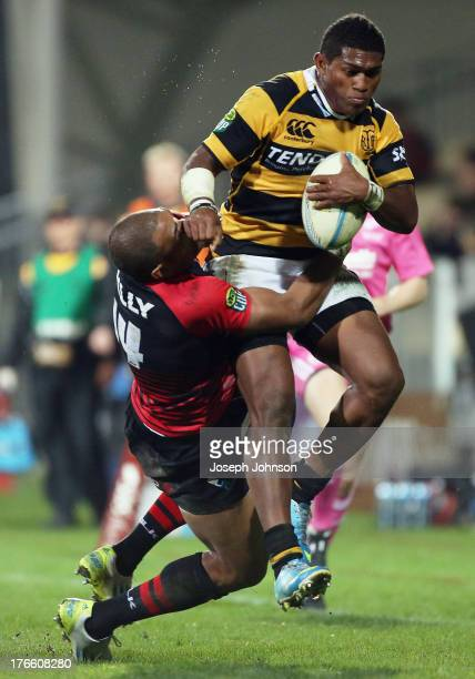 Waisake Naholo of Taranaki runs with the ball in the tackle of Patrick Osborne of Canterbury during the round 1 ITM Cup match between Cantebury and...