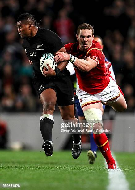 Waisake Naholo of the All Blacks beats the tackle of George North of Wales during the International Test match between the New Zealand All Blacks and...