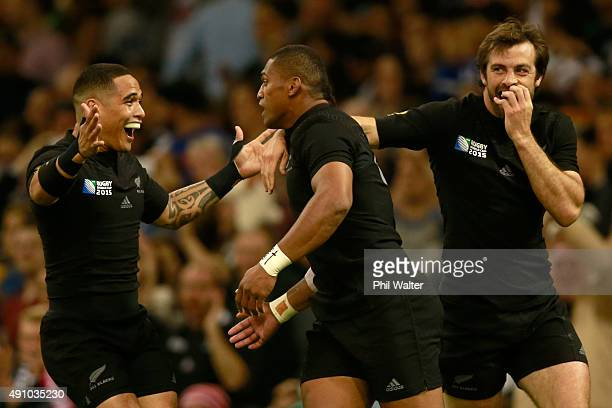 Waisake Naholo of the All Blacks is congratulated on his try by Aaron Smith and Conrad Smith during the 2015 Rugby World Cup Pool C match between New...