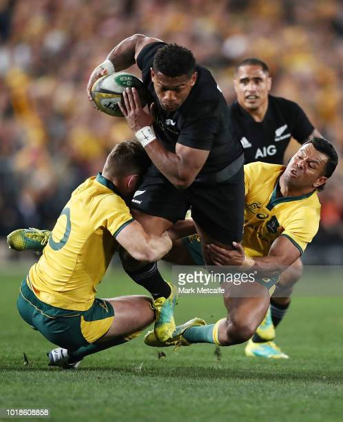 Waisake Naholo of the All Blacks is tackled by Bernard Foley of the Wallabies and Kurtley Beale of the Wallabies during The Rugby Championship...