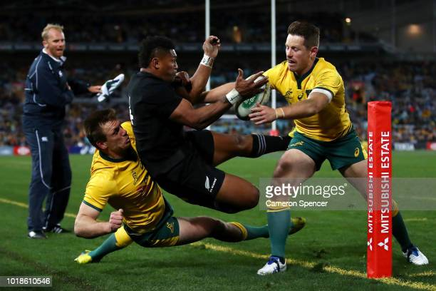 Waisake Naholo of the All Blacks is tackled short of the tryline during The Rugby Championship Bledisloe Cup match between the Australian Wallabies...