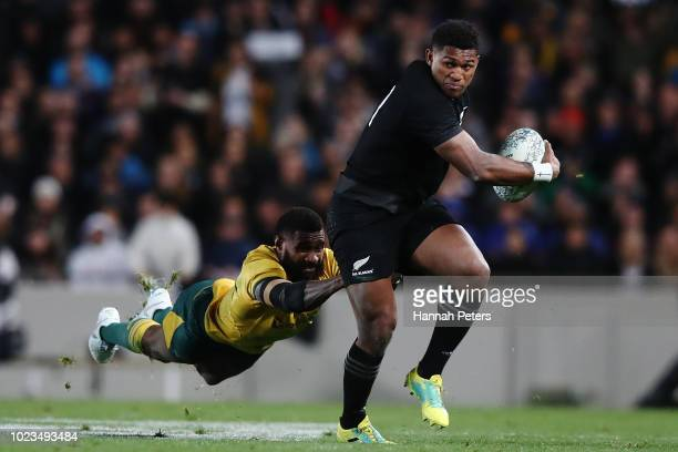 Waisake Naholo of the All Blacks makes a break during The Rugby Championship game between the New Zealand All Blacks and the Australia Wallabies at...