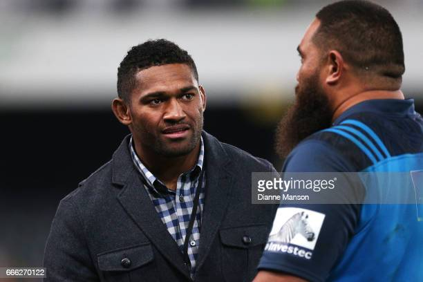 Waisake Naholo of the Highlanders and Charlie Faumuina catch up after the round seven Super Rugby match between the Highlanders and the Blues on...