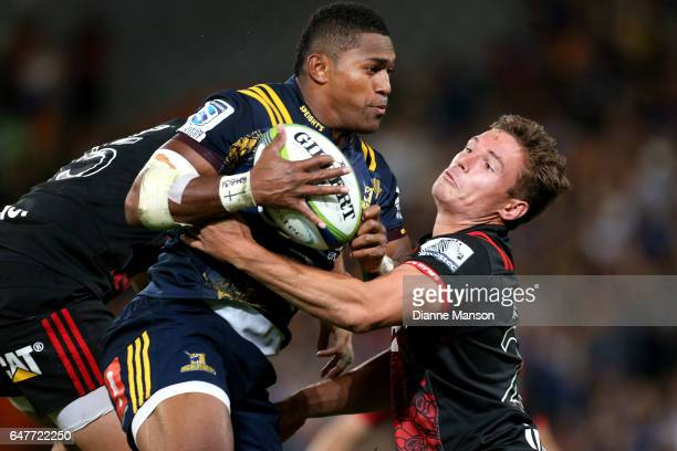 Waisake Naholo of the Highlanders and George Bridge of the Crusaders compete for the high ball during the round two Super Rugby match between the...