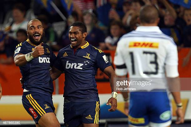 Waisake Naholo of the Highlanders celebrates his try with Patrick Osborne during the round seven Super Rugby match between the Highlanders and the...
