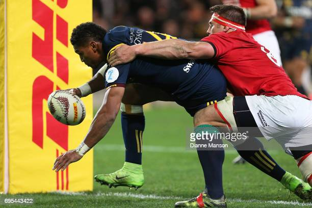 Waisake Naholo of the Highlanders dives over to score a try during the match between the Highlanders and the British Irish Lions at Forsyth Barr...