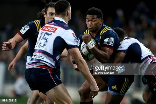 Waisake Naholo of the Highlanders fends off Jack Maddocks of the Rebels during the round 19 Super Rugby match between the Highlanders and the Rebels...