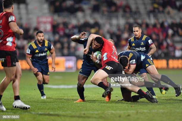 Waisake Naholo of the Highlanders is tacked by Jack Goodhue of the Crusaders during the round 18 Super Rugby match between the Crusaders and the...