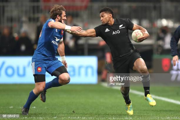 Waisake Naholo of the New Zealand All Blacks fends off Maxine Medard of France during the International Test match between the New Zealand All Blacks...