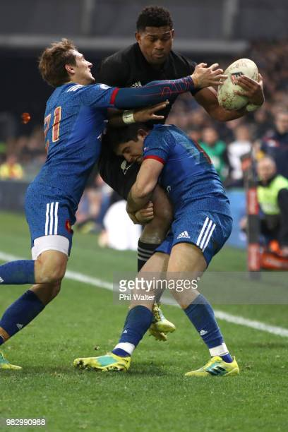 Waisake Naholo of the New Zealand All Blacks is tackled during the International Test match between the New Zealand All Blacks and France at Forsyth...