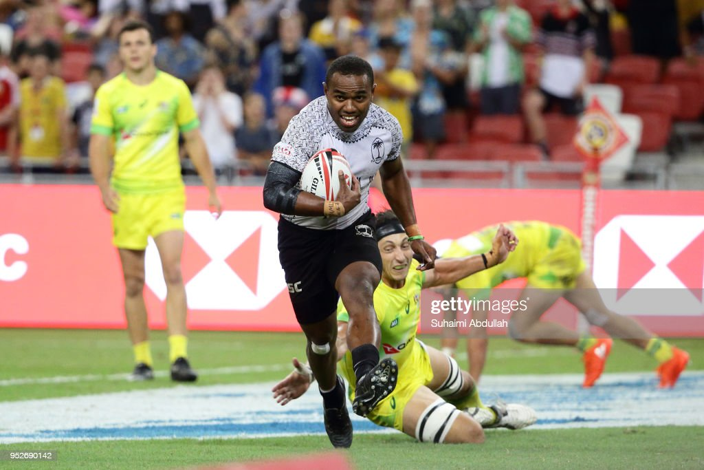 Waisea Nacuqu of Fiji runs the ball and scores a try during the 2018 Singapore Sevens Cup Final match between Australia and Fiji at National Stadium on April 29, 2018 in Singapore.