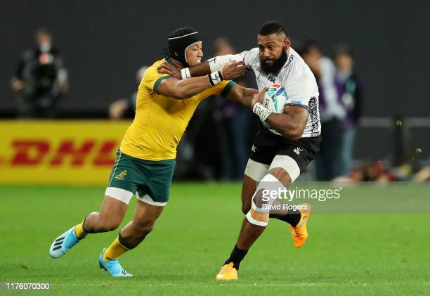 Waisea Nayacalevu of Fiji fends off Christian Lealiifano of Australia to score his side's second try during the Rugby World Cup 2019 Group D game...