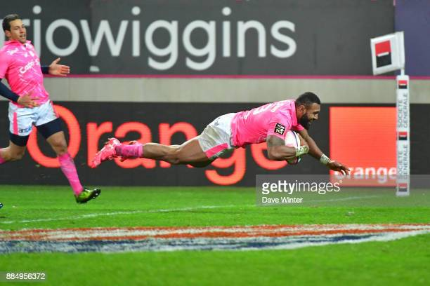 Waisea Nayacalevu of Stade Francais Paris dives over for his second try during the Top 14 match between Stade Francais and Racing 92 on December 3...