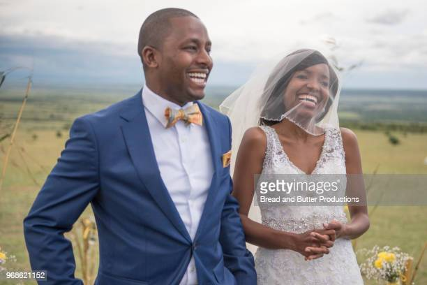 Waist Up Photo of Smiling Bride and Groom at Wedding Ceremony