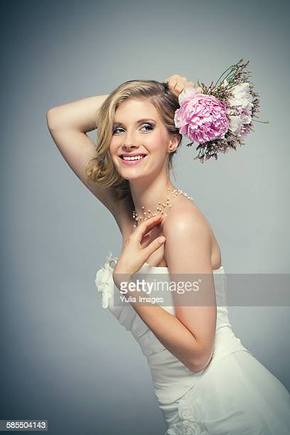 Waist up portrait of beautiful blond bride