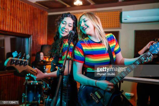 waist up portrait of contemporary music band rehearsing in studio - pop musician stock pictures, royalty-free photos & images