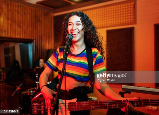 waist up portrait of contemporary music band rehearsing in studio - pop music stock pictures, royalty-free photos & images