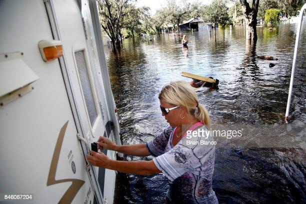 waistdeep in floodwater Shelly Hughes prepares to open the door and get her first look at the inside of her flooded camper at the Peace River...