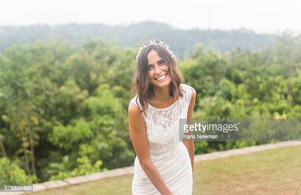 Waist-up portrait of bride, outdoors