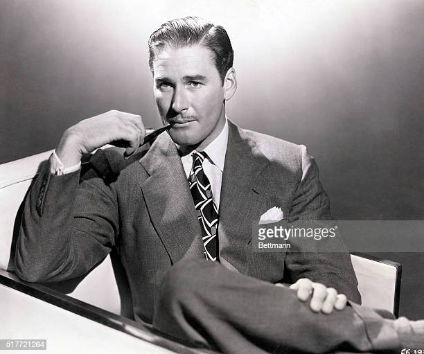 Waistup seated portrait of Errol Flynn smoking a pipe Flynn starred in over 60 films and was labelled the King of Swashbuckler Films He wanted to act...