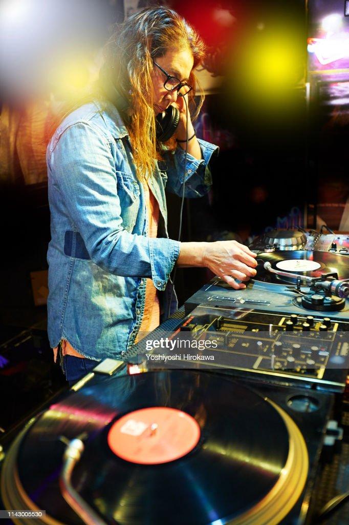 Waistup Shot Of Dj Playing Music At Nightclub In Party At