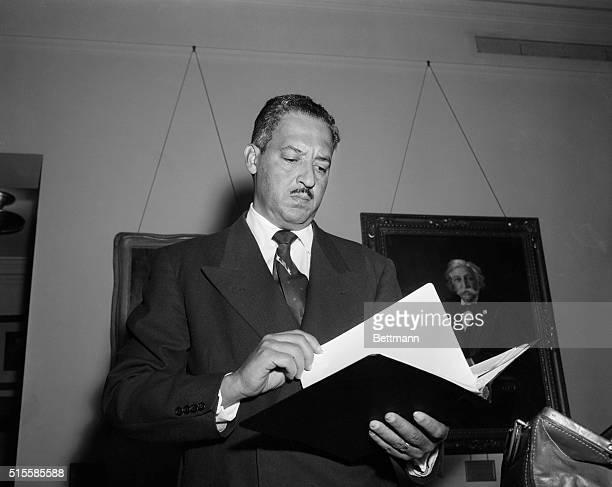 Waistup view of Thurgood Marshall holding book Photo circa 1955