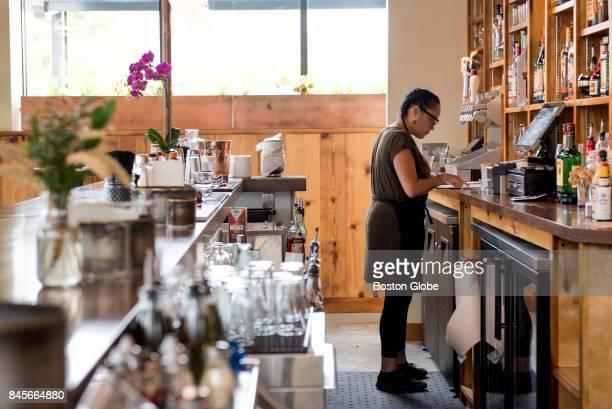 Wait staff member Torey Whitfield works behind the bar at Semolina Kitchen Bar in Medford MA on Aug 29 2017 The Semolina Kitchen Bar is a new...