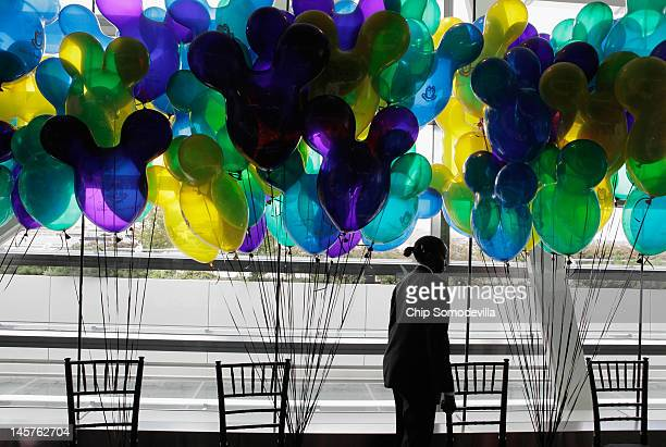 A wait staff member walks past a forrest of balloons during an event introducing The Walt Disney Companys new Magic of Healty Living program at the...